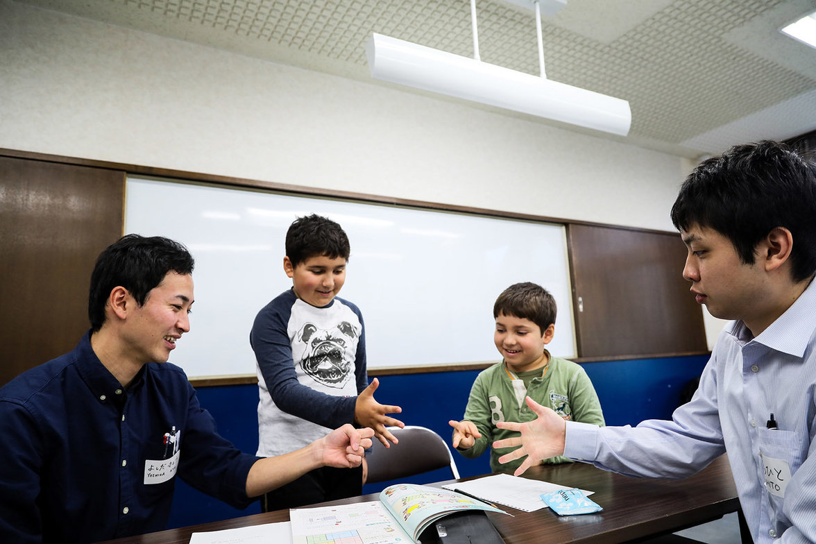 """Kanon, 7, and Rojhat, 10, are learning numbers during a japanese lesson organized by """"Japan Kurdistan Ftriendship Association"""". All teachers are volunteers who want to help the kurdish community in the integration process, as the majority of them are able"""