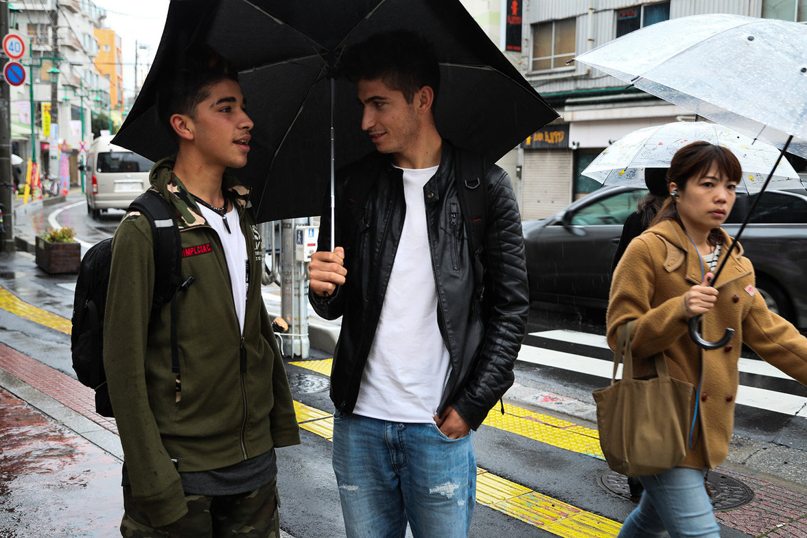 """Gokhan and Feti Waliking on the streets of warabi. They both work for construction companies. Gokhan come from Adiyaman and he said he decided to come in Japan """"to live"""". He lives alone with his aunt, he left the family in Kurdistan."""