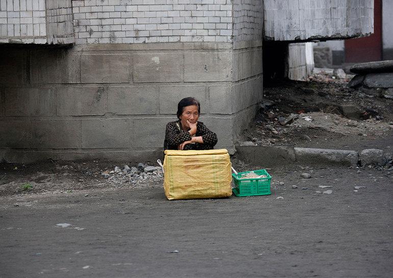 Eine Frau verkauft Eiscreme (Foto: Eric Lafforgue)