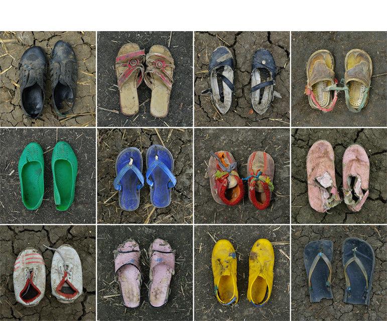 Schuhe von Flüchtlingen, die zehn Jahre oder jünger sind