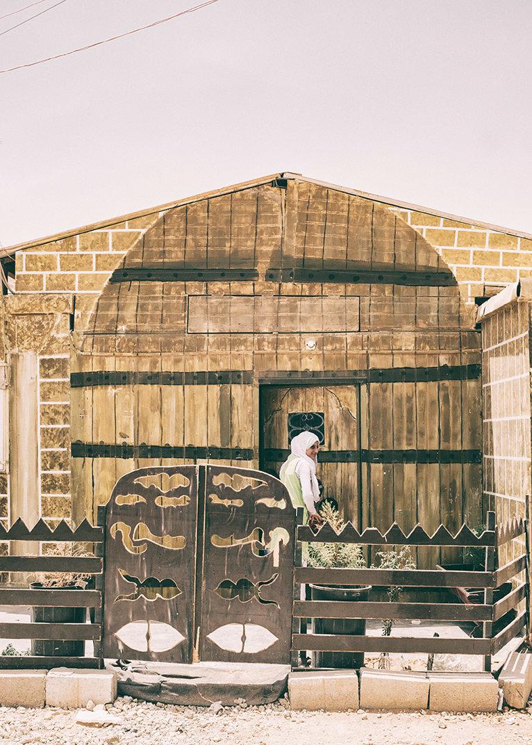 Haus mit selbstgebautem Zaun in Zaatari